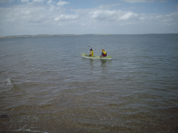 Exploding boy in a canoe at Phillip Island