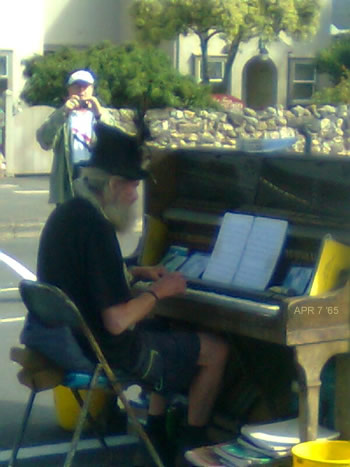 Outside the compound: Busker at Port Fairy