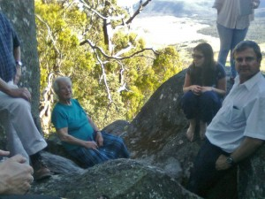 Lizzie sitting on a granite tor looking down on Orroral valley - scattering Dad's ashes